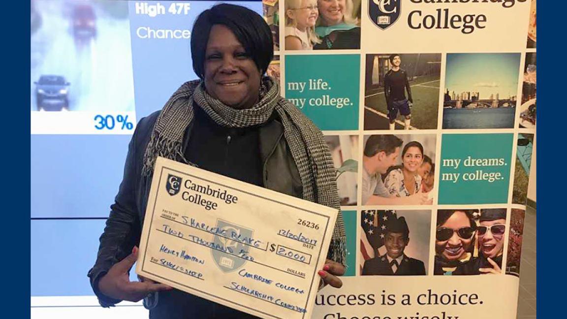 Sharlene Blake holding scholarship check